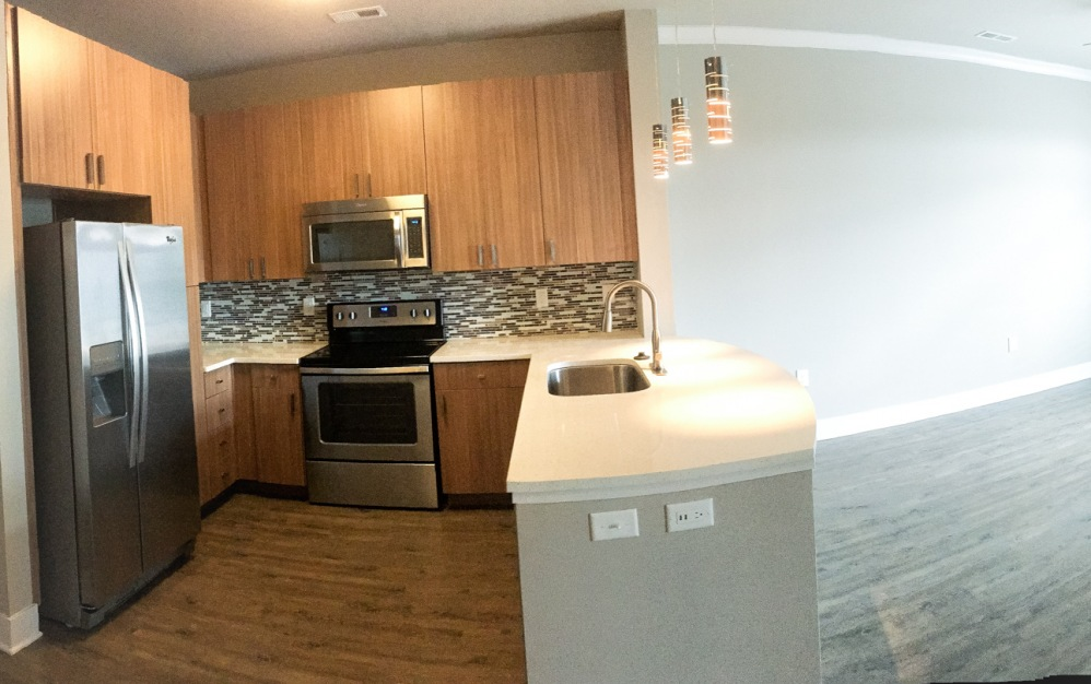 B1-2 - 1 bedroom floorplan layout with 1 bath and 702 square feet. (Pano)