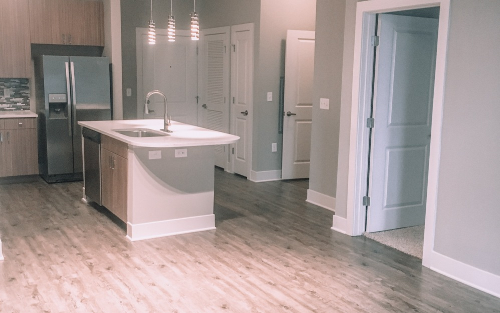 B1-4 - 1 bedroom floorplan layout with 1 bath and 784 square feet. (Kitchen)