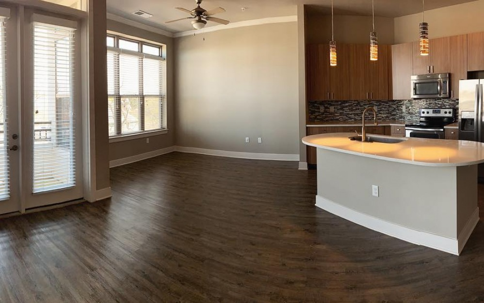 Expansive open concept one bedroom apartment with dining area or home office