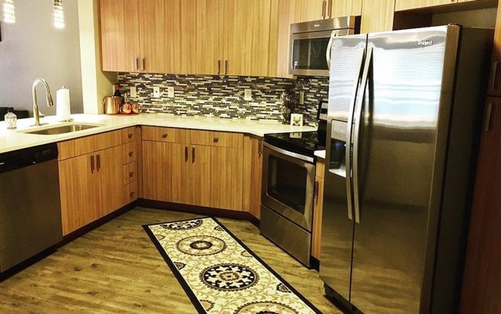 B1-3 - 1 bedroom floorplan layout with 1 bath and 711 square feet. (Kitchen)